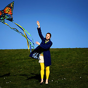 Nanny Aubrey Mayne helps launch a kite for her three young companions during a sunny day off from school for the children she cares for at Gasworks Park on Monday, February 18, 2008.  It was a warm and sunny Presidents Day holiday that brought many Seattleites out into the beautiful weather.  (Photo/Seattle Post-Intelligencer, Joshua Trujillo)
