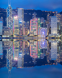 Night skyline of skyscrapers in Hong Kong from Kowloon on a clear day