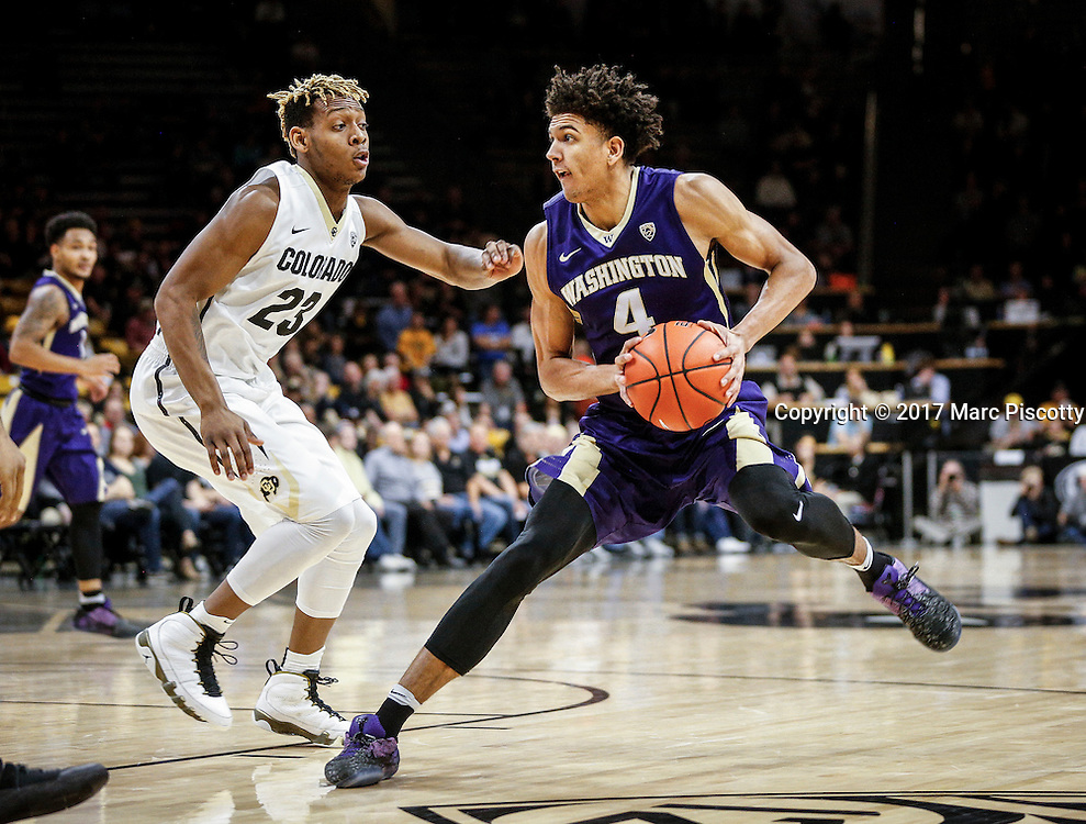 SHOT 2/9/17 10:13:50 PM - Washington's Matisse Thybulle #4 jump stops in front of Colorado's Bryce Peters #23 during their regular season Pac-12 college basketball game at the Coors Events Center in Boulder, Co. Colorado won the game 81-66. (Photo by Marc Piscotty / © 2017)