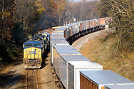 Passing on the main line in northwestern Indiana, two CSX trains make good time toward their destinations.