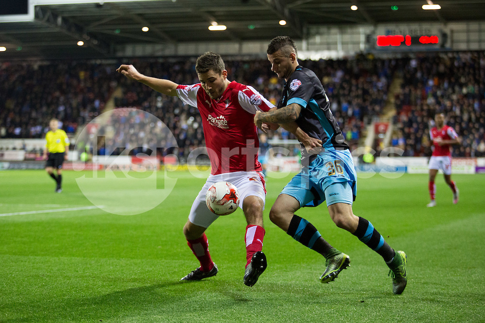 Lewis Buxton of Rotherham United holds off Daniel Pudil of Sheffield Wednesday during the Sky Bet Championship match between Rotherham United and Sheffield Wednesday at the Aesseal New York Stadium, Rotherham, England on 23 October 2015. Photo by James Williamson.