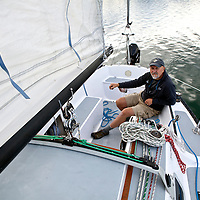 WA09109-00...WASHINGTON - Terry Donnelly sailing the waters off Vashon Island in the Puget Sound. (MR# D13)