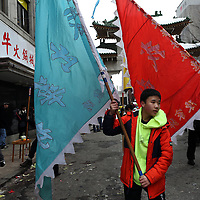 (Boston, MA - 3/1/15) A member of Wah Lum Kung Fun carries flags during a Lunar New Year celebration in Chinatown, Sunday, March 01, 2015. Staff photo by Angela Rowlings.
