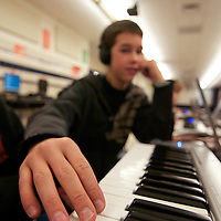 12/15/10 Middletown DE: Bunker Hill Elementary School Student Josiah Wible (12) practices playing the keyboard with the help of MusIQ software at Bunker Hill Elementary School in Middletown Delaware.....Special to The News Journal/SAQUAN STIMPSON