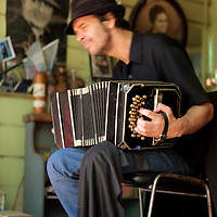 South America, Argentina, Buenos Aires. Bandoneon Player in La Boca.