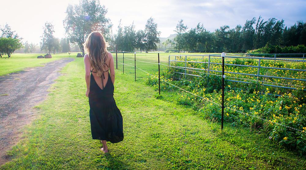 Woman in field wearing Tiare Hawaii Lanai Dress in Black<br /> www.tiarehawaii.com<br /> Model: Andrea Hannemann