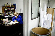 Liz Fenimore checks on job prospects in her old office that her employer lets her use for job research in Sacramento, Calif. January 17, 2011.