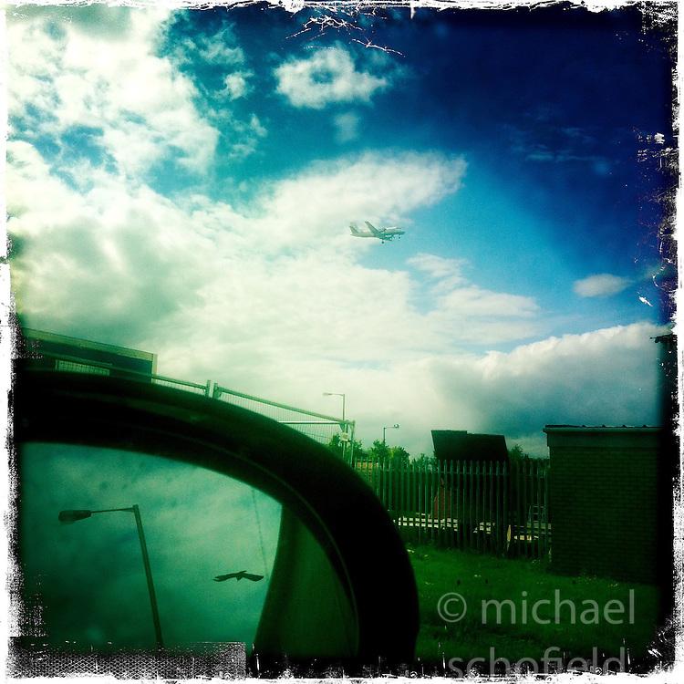 Jet landing at Edinburgh airport..Hipstamatic images taken on an Apple iPhone..©Michael Schofield.