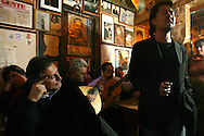 "A japanese singing Fado at ""Tasca do Chico"". This is one of the typical spots were to see live perfomances of Fado music and were the audience can spontaneously participate and also ask to sing. It is located in  Bairro Alto neighborhood"