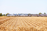 Amtrak's westbound California Zephyr flies across the farms fields of Central Illinois near Cameron. This is shortly after the train's stop in Galesburg, IL on its way to the west coast.