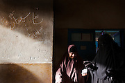 Egyptian women exit a polling center after casting their votes during the second day of the historic democratic Presidential election May 24, 2012 in the Imbaba district of Cairo Egypt.  The results of the election will help determine to what extent religion will play a role in politics throughout the country. (Photo by Scott Nelson)