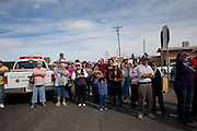 Residents gather for a parade in Columbus, New Mexico. Recently federal authorities arrested the mayor, police chief, and trustees who were allegedly operating an illegal gun running ring.