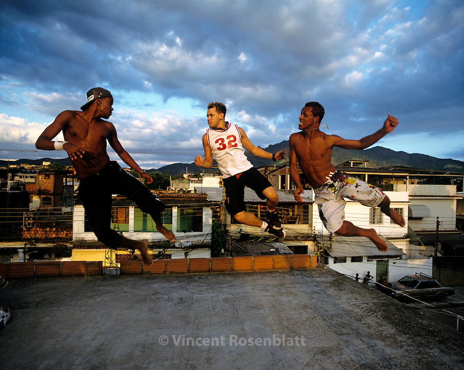 The Hawaianos, one of the most famous boys band of the Carioca funk scene, rehearse on a rooftop in the favela Cidade de Deus (City of God).  Their success is due to their choreographic creativity :  They transform the movements of TV comics heroes into dance steps.  Every weekend, they go on the roads of Rio de Janeiro State to perform in about ten bailes, for which they get paid between 200 and 2000 euros each show.  Cidade de Deus, Rio de Janeiro, 2007.