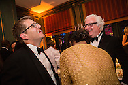 White House Press Secretary Jay Carney, left, laughs with guests at the Bloomberg Vanity Fair White House Correspondents' Association dinner afterparty at the residence of the French Ambassador on Saturday, April 28, 2012 in Washington, DC. Brendan Hoffman for the New York Times