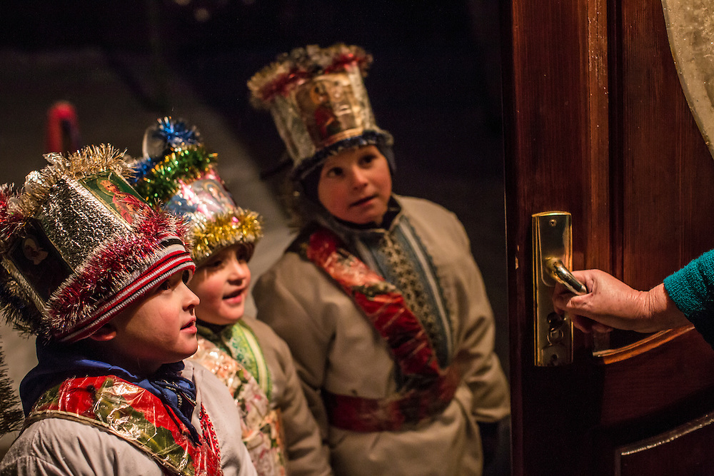 ILTSI, UKRAINE - JANUARY 6: Nazar, Stas, and Vasyl Mahulia (L-R), ages 6, 5, and 7 respectively, are greeted while caroling door to door in celebration of Orthodox Christmas on January 6, 2015 in Iltsi, Ukraine. While many of the traditions are similar across Ukraine, the songs and clothing of the Hutsul culture are common in the Carpathian Mountains. (Photo by Brendan Hoffman/Getty Images) *** Local Caption *** Vasyl Mahulia;Stas Mahulia;Nazar Mahulia