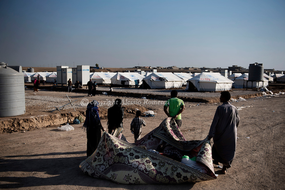 Iraq: IDP's bring their belonging wrapped in a carpet inside Assan Shame IDP camp after fleeing fighting in Mosul on November 5, 2016. Alessio Romenzi