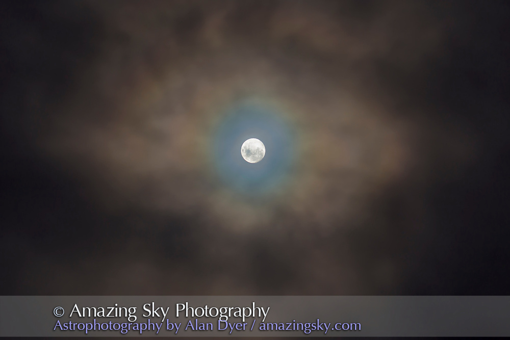 The nearly Full Moon of April 10, 2017 as seen from Australia, and embedded in fast-moving low cloud adding the colourful corona effect around the Moon from water-droplet diffraction. <br /> <br /> Being in the southern hemisphere, the Full Moon appears &ldquo;upside-down&rdquo; compared to a northern view.<br /> <br /> This is a 7-image blend of exposures from 1/2 second to 1/30-second to capture both the faint clouds and bright Moon. I blended them with luminosity masks (generated with ADP Panel+ Pro) rather than attempting an HDR stack which rarely works well for the Moon.