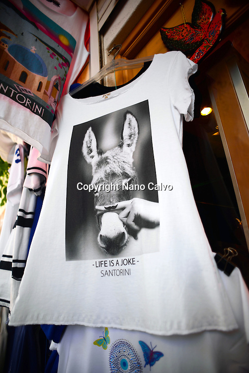 "Funny T-Shirt shows a donkey and reads ""Life is a Joke"", Fira, Santorini, Greek Islands, Greece"