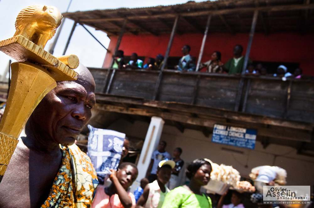 A man holds a staff adorned with a golden porcupine during the parade held on the occasion of the annual Oguaa Fetu Afahye Festival in Cape Coast, Ghana on Saturday September 6, 2008.
