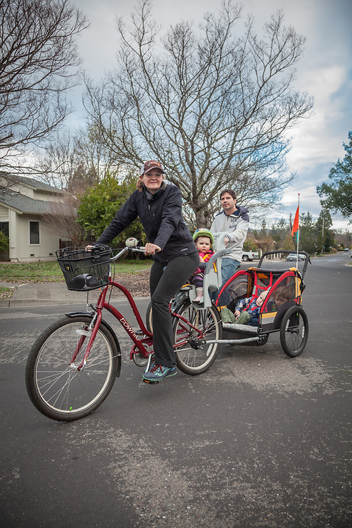 """""""We met at the Cullinary Institute of America in Hyde Park, New York...Ryder is the  executive chef at Archetype in Saint Helena and I worked for The French Laundry before we started having babies.""""     """"We bike daily...the kids total 100 (lbs.) and then the weight of the seat and bike extension...30 minutes is quite a workout."""" -Michaella Zetts with husband, Ryder, daughter, Daisy, and sons, Vinnie and Fenton, near their home in Calistoga  mzetts@gmail.com"""