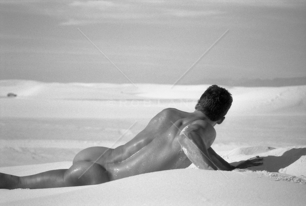 male nude outdoors in White Sands National Park, New Mexico