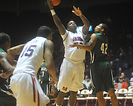"Ole Miss center Demarco Cox (42)  shoots as Mississippi Valley State's Jason Holmes (42) defends at C.M. ""Tad"" Smith Coliseum in Oxford, Miss. on Monday, December 13, 2010."
