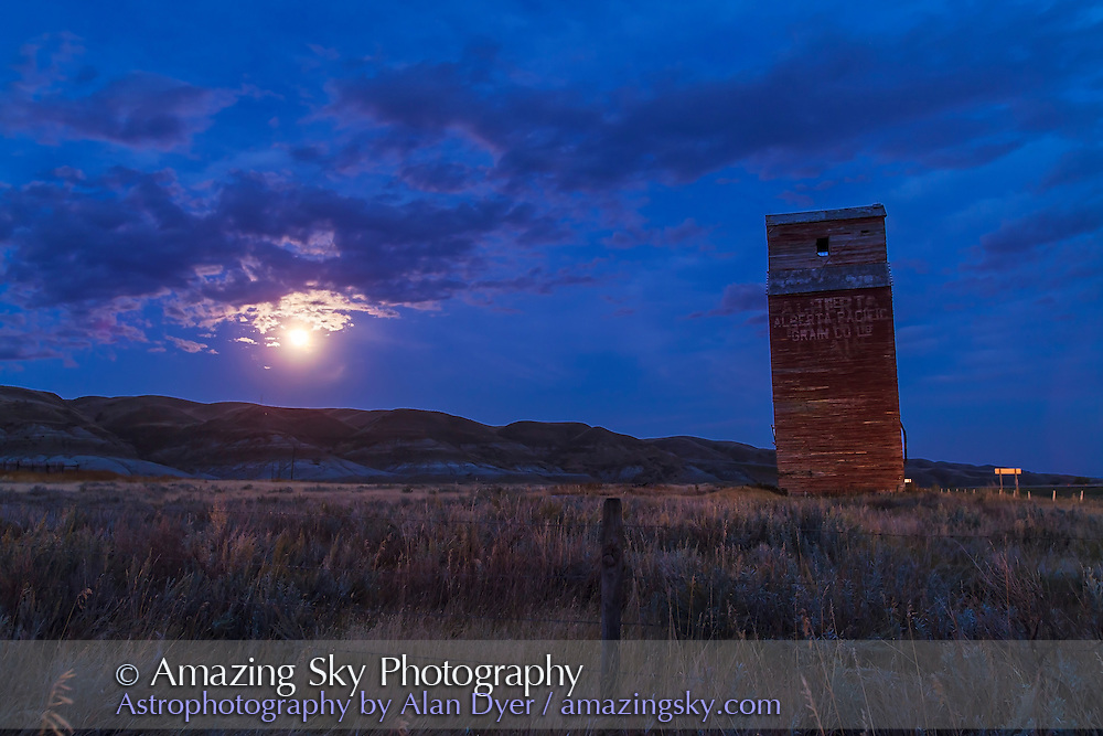 The old grain elevator at Dorothy, Alberta and the Full Harvest Moon, Sept 29, 2012. Taken as part of a 400-frame time-lapse sequence. With Canon 5D MkII and 16-35mm lens. Exposure with Little Bramper intervalometer.