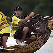 SHOT 7/29/2007 - The Ronin Dragons flag catcher was all smiles after managing to pull himself back into the boat after nearly falling into Sloan's Lake at the 2007 Colorado Dragon Boat Festival. Had he fallen in it would have cost the team the race because it would have disqualified them. The sport of Dragon boat racing is over 2000 years old and features teams of 18 paddlers - nine men and nine women plus someone to steer the boat - all rowing in sync to the beat of a drum and racing to a flag 200 meters away on Sloan's Lake in Denver, Co. Founded in 2001 to celebrate Denver?s rich Asian Pacific American culture, the Colorado Dragon Boat Festival has become the region?s fastest growing and most acclaimed new festival. Festival-goers get to explore the Asian culture through demonstrations, crafts, shopping, eating, and the growing sport of dragon boat racing. .(Photo by Marc Piscotty / © 2007)