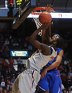 Mississippi's Terrance Henry (1) has his shot blocked by Florida's Vernon Macklin during a college basketball game in Oxford, Miss. on Saturday, February 20, 2010.  (AP Photo/Oxford Eagle, Bruce Newman)