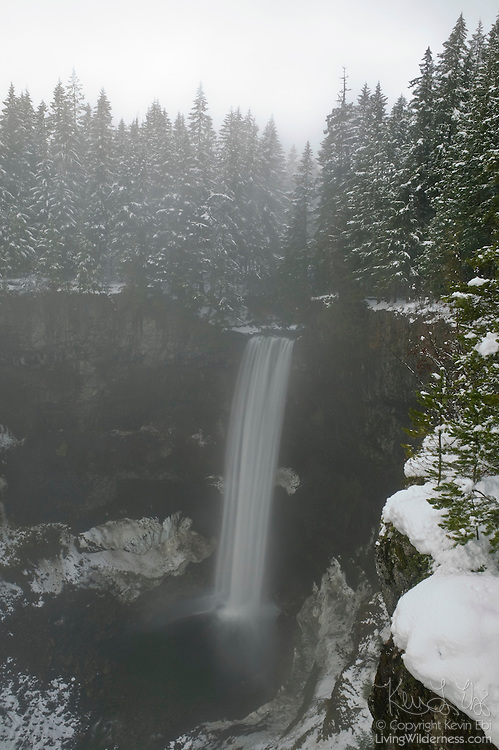 Fresh snow covers the landscape surrounding Brandywine Falls, a 230-foot (70 meter) waterfall south of Whistler, British Columbia, Canada.