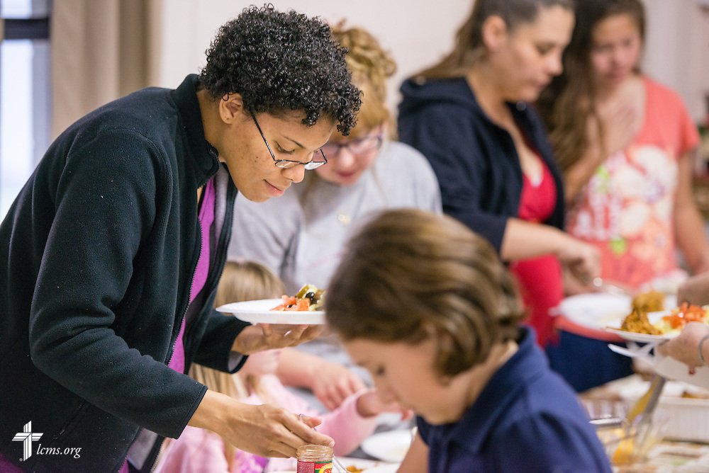 Jenny eats with congregation members during  a fellowship meal at Lutheran Church of the Redeemer on Thursday, Feb. 12, 2015, in Sanford, Fla.  LCMS Communications/Erik M. Lunsford