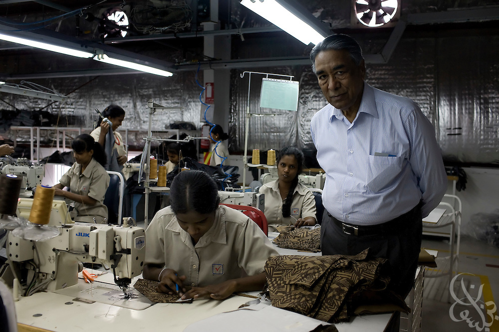 Sri Lankan workers operate a production line for blue jeans at the Velocity Apparelz CO factory October 27, 2008 in Ismailia ,130 kilometers north of Cairo, Egypt.  The Indian owned jeans company has been open in Egypt since 2001, employing 2700 Egyptian workers and several hundred other foreign workers while supplying jeans to major companies that include Levis, Gap, Target, and Zara.