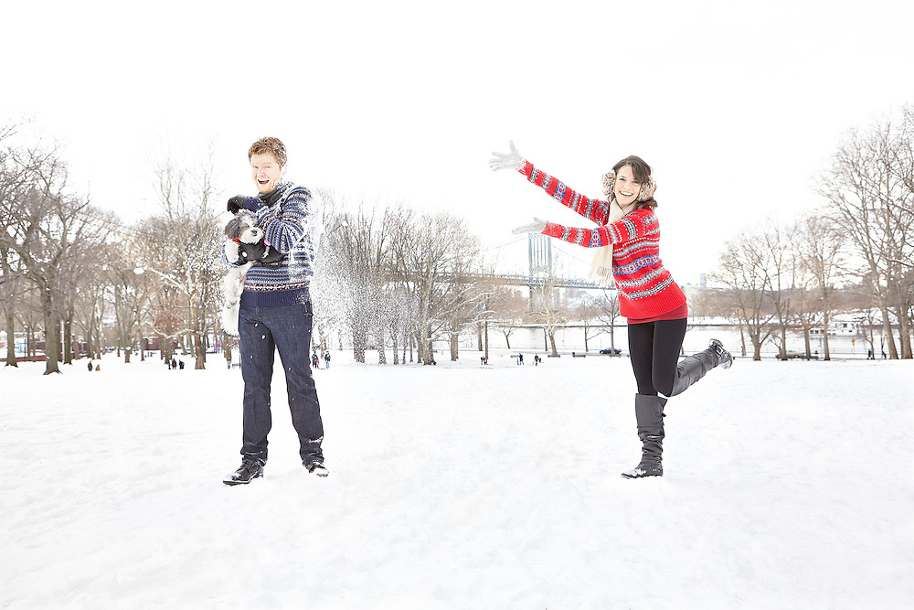 Lifsetyle image of young couple playing with snow in park