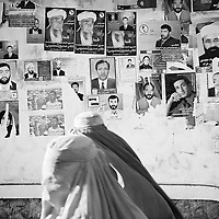 Afghan women in burqa, passing election posters on the streets of Kabul, Afghanistan.