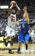 "Mississippi's Jarvis Summers (32) shoots against Kentucky's Jarrod Polson (5) at the C.M. ""Tad"" Smith Coliseum on Tuesday, January 29, 2013.  (AP Photo/Oxford Eagle, Bruce Newman).."