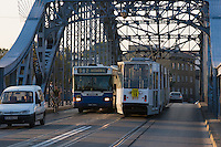 old tram and new bus seen crossing pilsudski bridge from krakow's kazimierz district to podgorze in sunshine in september 2005
