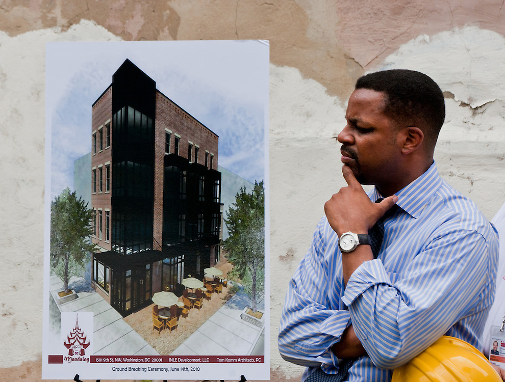 At-Large Councilman Kwame Brown considers a rendering of a proposed development in Shaw.