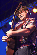 Colin Melloy of the Decemberists is concentrating on a solo during the band's set at the Pitchfork/Intonation Music Festival in Chicago's Union Park.