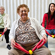 Audrey Nguyen, OT13, laughs at Ida M. Fazio's joke during a pilates class at the Medford Senior Center. (Alonso Nichols/Tufts University)