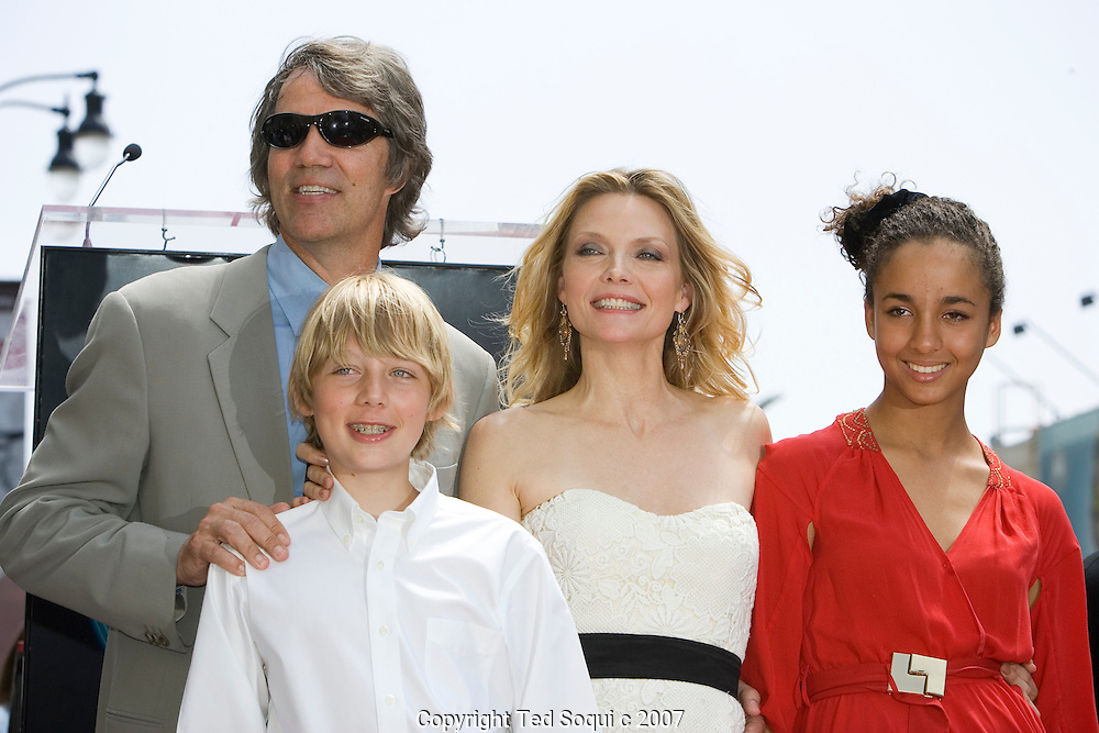 """Michelle with her husband and two children..Michelle Pfeiffer honored with star on the Hollywood Walk Of Fame. This was the 2,345 Star on the Hollywood Walk Of Fame. .Michelle starred in """"Scarface"""", """"Love Field"""", """"The Fabulous Baker Boys"""", and Frankie and Johnny."""" .Jeff Bridges and Paul Rudd were also there to honor her..Hollywood and Highland Complex, Hollywood, CA"""