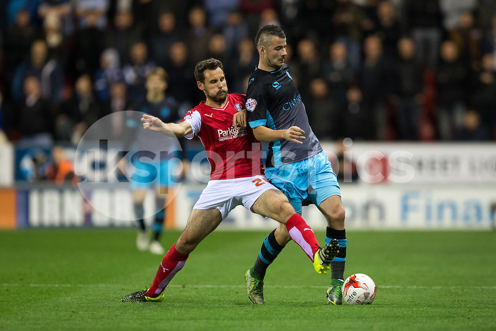 Tony Andreu of Rotherham United tackles Daniel Pudil of Sheffield Wednesday during the Sky Bet Championship match between Rotherham United and Sheffield Wednesday at the Aesseal New York Stadium, Rotherham, England on 23 October 2015. Photo by James Williamson.