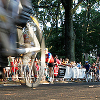 Cyclists pass the starting point for the annual 24 Hours of Booty bike ride.  Photographed for the Charlotte Observer in July 2011.