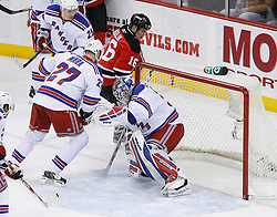 Feb 9, 2009; Newark, NJ, USA; New Jersey Devils center Bobby Holik (16) scores a goal past New York Rangers goalie Henrik Lundqvist (30) during the second period at the Prudential Center.
