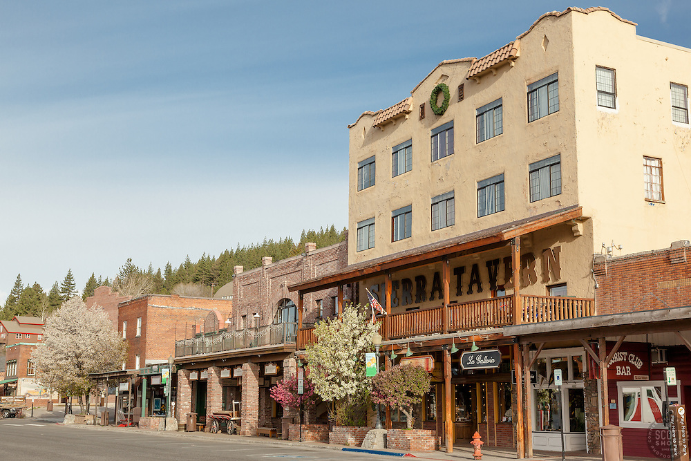 """""""Downtown Truckee 16"""" - Photograph of the Sierra Tavern  and other buildings in historic Downtown Truckee, California with blossoming cherry tree and crabapple trees in the foreground."""