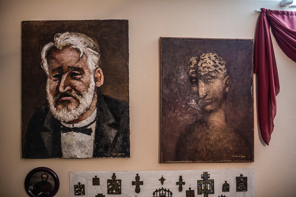 ODESSA, UKRAINE - MARCH 26, 2015: Portraits of poet Boris Khersonsky, painted by friend and artist Aleksandr Roytburd, adorn the walls of his city apartment in Odessa, Ukraine. CREDIT: Brendan Hoffman for The New York Times