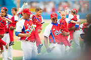 HAVANA, CUBA - MARCH 22, 2016: Young children escort members of the Cuban National Team as they are introduced during a pre-ceremony on the field before the start of the game between the Tampa Bay Rays and the Cuban National Team at Estadio Latinoamericano on March 22, 2016 in Havana, Cuba. (Photo by Jean Fruth)