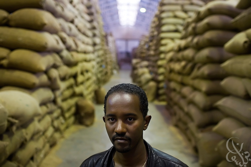 Ashenafi Argaw, export division head for the Sidamo Coffee Farmers Co-operative Union (SCFCU), checks co-op members' coffee supplies at the warehouse of the Keffa Export Coffee Processing Plant February 24, 2007 in Addis Ababa, Ethiopia.  The SCFCU represents the interests of more than 86,000 Ethiopian farmers from 47 cooperatives in the Sidamo region.
