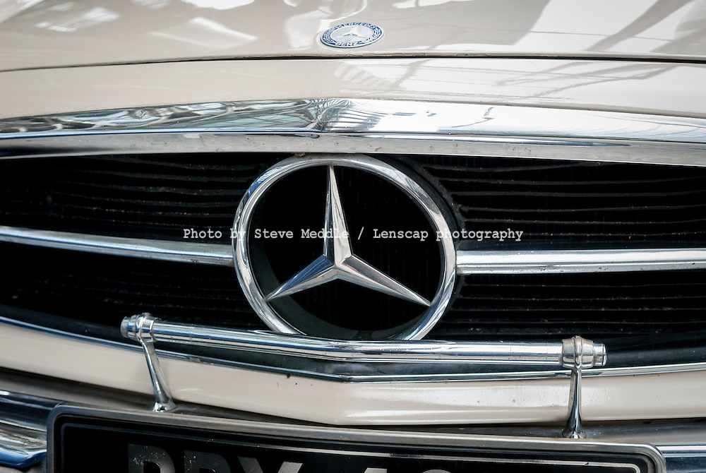 Mercedes-Benz Badge on Front Grille of Car