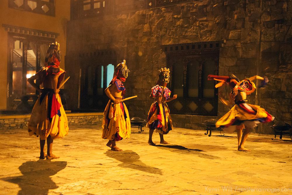 Asia, Bhutan, Thimpu. Traditional Bhutanese dancers at the Taj Tashi Hotel.