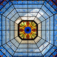 Indiana State Capitol Rotunda Dome in Indianapolis, Indiana<br /> 105 feet above the rotunda floor at the Indiana State Capitol in Indianapolis is this 72 foot inner dome with delightful blue tones. The exquisite stained glass shines brightly regardless of the weather thanks to a 1988 restoration when lighting and reflective paint were added to the inner dome above the glass.